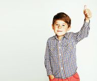 Young pretty little cute boy kid wondering, posing emotional fac. E isolated on white background, gesture happy smiling close up, lifestyle real people concept royalty free stock image