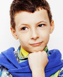 Young pretty little cute boy kid wondering, posing emotional face isolated on white background, gesture happy smiling Stock Images