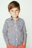 Young pretty little cute boy kid wondering, posing emotional face isolated on white background, gesture happy smiling Royalty Free Stock Photos