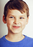 Young pretty little cute boy kid wondering, posing face  on white background, gesture happy smiling close up Royalty Free Stock Images