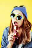 Young pretty long hair teenage hipster girl posing emotional happy smiling on yellow background, lifestyle people Stock Image