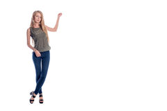 Young pretty long haired blonde woman posing in casual clothes presenting, showing something to copy space isolated on Stock Photography