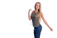 Young pretty long haired blonde woman posing in casual clothes presenting, showing something to copy space isolated on Royalty Free Stock Photography