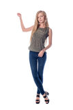 Young pretty long haired blonde woman posing in casual clothes presenting, showing something to copy space isolated on Stock Photo