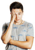 Young pretty man with head ache holding hands Stock Photos