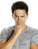 Young pretty man with head ache holding hands Royalty Free Stock Photo
