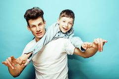 Young pretty man model with little cute son playing together, li Royalty Free Stock Photography