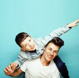 Young pretty man model with little cute son playing together, li. Festyle modern people concept, family male close up Stock Image