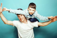 Young pretty man model with little cute son playing together, li. Festyle modern people concept, family male close up Stock Photography