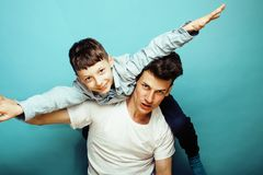 Young pretty man model with little cute son playing together, li. Festyle modern people concept, family male close up Royalty Free Stock Image