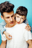 Young pretty man model with little cute son playing together, lifestyle modern people concept, family male Stock Image