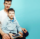 Young pretty man model with little cute son playing together, lifestyle modern people concept, family male. Young pretty men model with little cute son playing Royalty Free Stock Photography