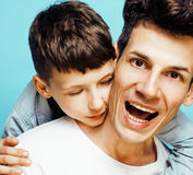 Young pretty man model with little cute son playing together, lifestyle modern people concept, family male. Young pretty men model with little cute son playing Stock Photography