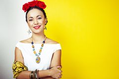 Young pretty mexican woman smiling happy on yellow background, lifestyle people concept. Closeup stock image