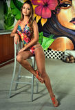Young pretty model in colorful swimsuit posing indoor. Young pretty model in colorful swimsuit posing indoor against graffiti wall Royalty Free Stock Photography