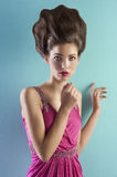 Young pretty model dressed in pink and with haute Stock Images
