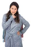 Young pretty model with winter clothes keeping secret Stock Photos