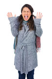 Young pretty model with winter clothes shouting Stock Images