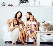 Young pretty modern family at home happy smiling, lifestyle peop. Le concept, mother with cute little daughter, sister twins together close up stock photo