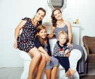 Young pretty modern family at home happy smiling, lifestyle peop. Le concept, mother with cute little daughter, sister twins together close up stock photography