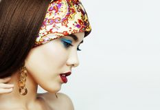 Young pretty modern girl with bright shawl on head emotional pos. Ing isolated on white background, asian people ethnicity close up Royalty Free Stock Images