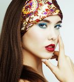 Young pretty modern girl with bright shawl on head emotional pos. Ing isolated on white background, asian people ethnicity close up Stock Image