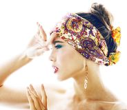 Young pretty modern girl with bright shawl on head emotional pos stock photo