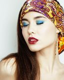 Young pretty modern girl with bright shawl on head emotional pos Stock Image