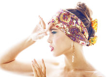 Young pretty modern girl with bright shawl on head emotional posing isolated on white background, asian people ethnicity. Close up Stock Images
