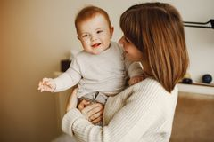 Mother with son. Young and pretty mother playing with hre son at home royalty free stock photo