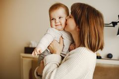 Mother with son. Young and pretty mother playing with hre son at home royalty free stock photography