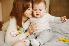 Mother with son. Young and pretty mother playing with hre son at home stock photo