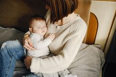 Mother with son. Young and pretty mother playing with hre son at home stock image