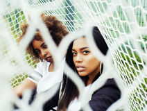 Young pretty multi ethnicity afro-american girls having fun on f Royalty Free Stock Photos