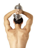 Young pretty muscleman back and dumbbell Stock Images