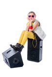 A young and pretty musician is sitting on loudspeakers Royalty Free Stock Photography