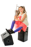 A young and pretty musician is sitting on loudspeakers Royalty Free Stock Image