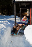 Young pretty Norwegian woman relaxing in the snow Royalty Free Stock Image