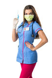 Young pretty nurse in mask mouth   with injection, Royalty Free Stock Photos