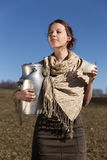 Young pretty peasant woman drinking fresh milk Royalty Free Stock Photography