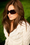 Young pretty pensive girl in sunglasses Stock Photo