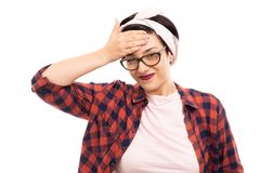 Young pretty pin-up girl wearing glasses showing headache gesture. stock image