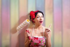 Young pretty pin up lady holding paint roller Stock Photography