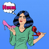 Young Pretty Pop Art Woman Making Choise on Shopping Between Shoes Stock Image