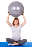 Young pretty pregnant woman doing exercises with fitball isolate. D on white background Royalty Free Stock Photo
