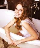 Young pretty real brunette girl enjoying bath with Stock Photos