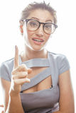 Young pretty real brunette woman secretary in sexy dress wearing glasses isolated on white background pointing gesturing Royalty Free Stock Photography