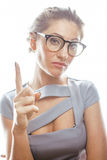 Young pretty real brunette woman secretary in sexy dress wearing glasses isolated on white background pointing gesturing Stock Photo