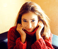 Young pretty real woman in red sweater and scarf all over her fa Stock Photography