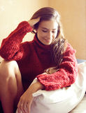 Young pretty real woman in red sweater and scarf all over her fa Royalty Free Stock Photo